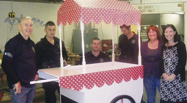 Putting the finishing touches to the Candy Floss Cart at TREE Training Centre are: Robert Aiken, Paul Robinson, Gary Dowie, Graham Bowden, Angela Johnston and Paula Bradshaw