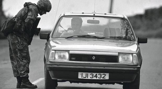 A car is stopped by a soldier in Castlederg in 1991
