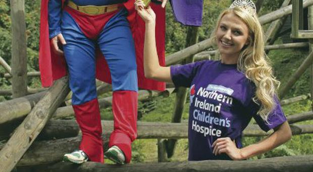 Miss Northern Ireland Meagan Green helps Zooperman go out on a limb for the NI Hospice Robbie Donaldson