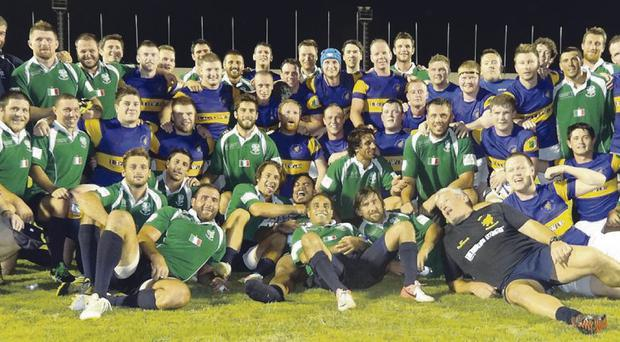 Bangor Rugby Club's squad pitch in for a post game photo with Benetton Treviso