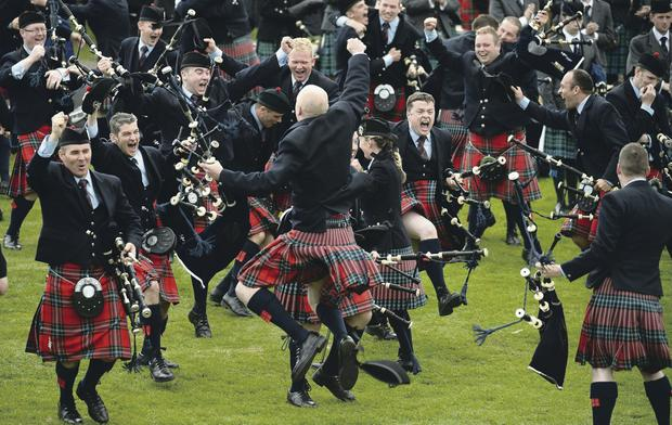Field Marshal Montgomery celebrate winning the 2013 World Pipe Band Championships at Glasgow Green