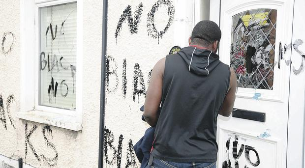 The Nigerian man at his Wayland Street home which was targeted in a race hate graffiti attack