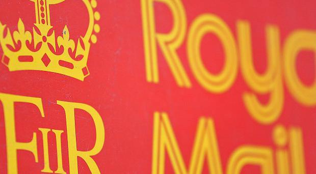 Royal Mail managers have voted overwhelmingly against the Government's controversial plans to privatise the postal organisation.