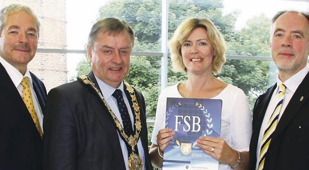 Wilfred Mitchell, FSB Northern Ireland Policy Chairman; the Mayor, Alderman Fraser Agnew; Sharon Logue, the Council's Procurement Manager and Roger Pollen, Head of External Affairs FSB