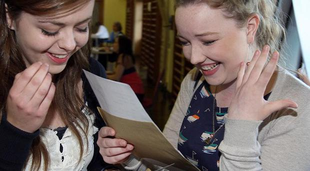 Emer McLaughlin, left, and Clara Scuillion, from St Louis Grammar school in Ballymena, celebrate their GCSE results