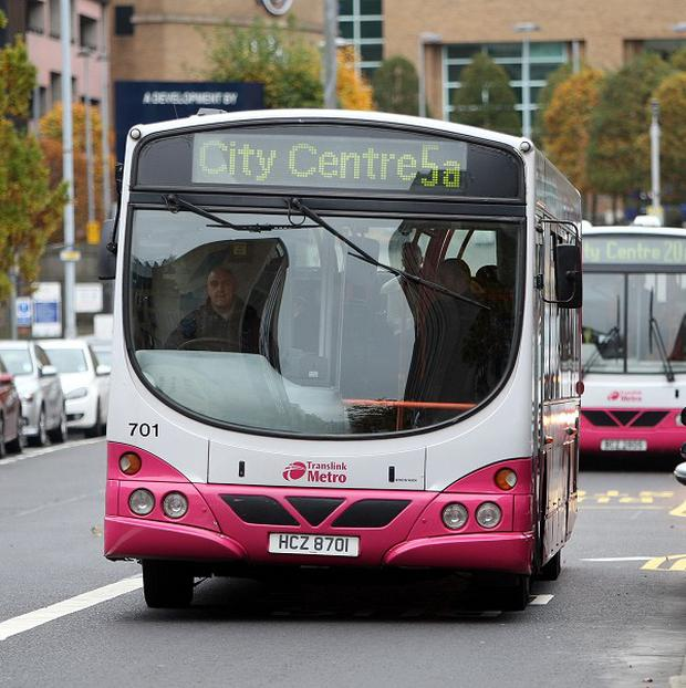 A bus driver has been robbed at knifepoint and another was injured in two incidents in Belfast