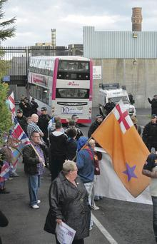 Loyalist protesters block a road after a bus carrying nationalists from Ardoyne arrived at the gates of the Crumlin Road jail