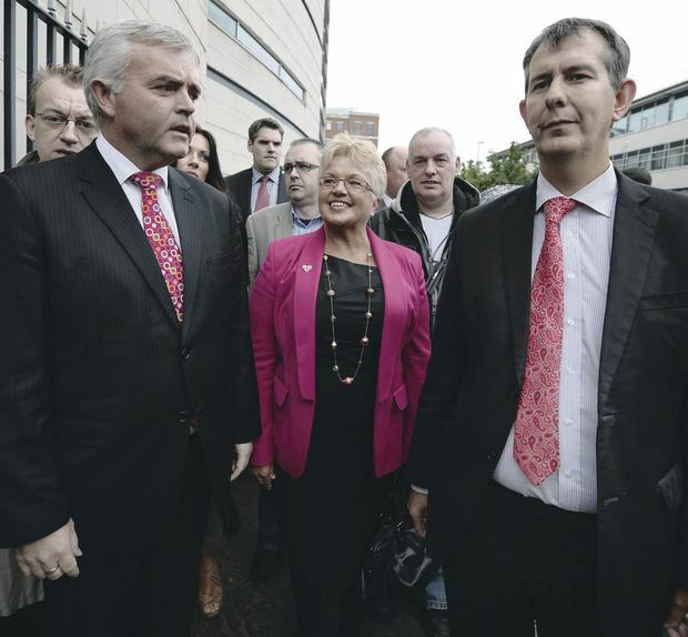 DUP councillor Ruth Patterson outside Belfast Laganside courts escorted by MLAs Jonathan Bell and Edwin Poots