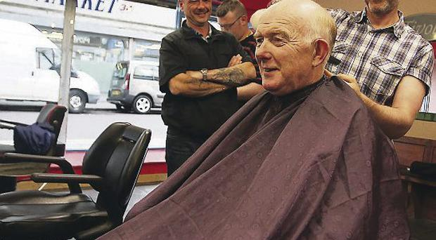 Eddie McGlinchey has his hair trimmed by Danny Bar in the new shop on North Street