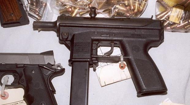 Handout photo of part of the arms seizure by Northern Ireland police which has led to the arrest of four men and two women, Tuesday November 26, 2002, after police smashed an international IRA arms smuggling plot. The suspects were held during swoops on houses in Belfast and North Antrim. Police in the Irish Republic, the FBI and Scotland Yard have also been involved in thwarting attempts by the Provisionals to secretly import a consignment of guns. See PA Story ULSTER Guns. PA Photo/Northern Ireland Police Service