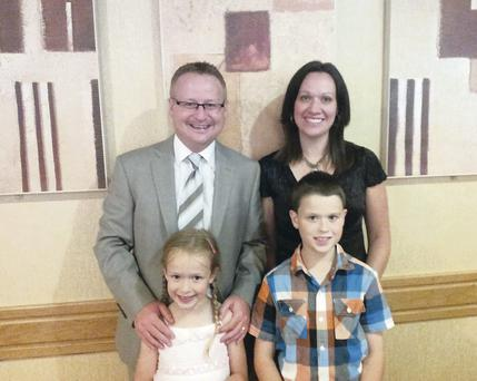 Pastor Johnny and his wife Emma pictured, with their children