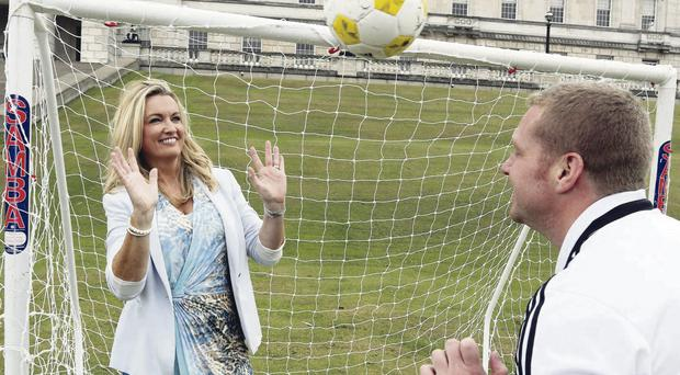 Jo-Anne Dobson helps launch Northern Ireland's first ever Goal tournament yesterday with Ross Oliver of the Irish Football Association