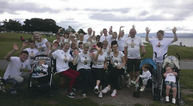 Extended family and friends of Clara Saunders gather for their sponsored 10 mile walk
