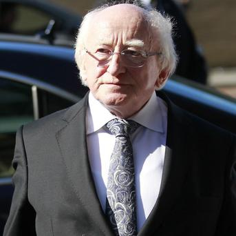 Irish President Michael D Higgins attends the funeral of Irish poet Seamus Heaney at the Church of the Sacred Heart in Donnybrook, Dublin