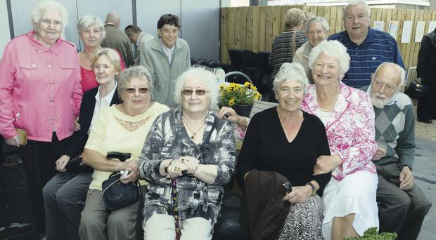 Guests attend the open of the community garden at the Skainos Centre in East Belfast. The garden was opened officially this morning by Dame Mary Peters