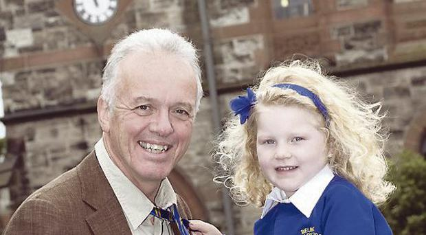 Noel Thompson a past pupil at Belmont with Heidi Gillespie a P1 pupil from Belmont Primary School