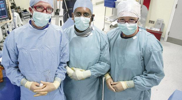 Medical team, led by consultant cardiologists Dr Ganesh Manoharan (centre) and Dr Mark Spence with Dr Sandra Gowdy