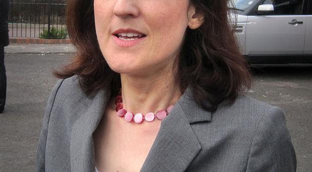 Northern Ireland Secretary Theresa Villiers says the tentative economic recovery will be threatened if violent disorder continues to generate negative headlines.
