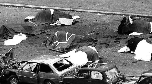 Dead horses covered up and wrecked cars at the scene of carnage in Rotten Row, Hyde Park, after an IRA bomb exploded as the Household Cavalry was passing.