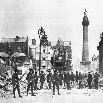 Scene from O'Connell Street in Dublin, during the Easter Rising. In the background is Nelson's Pillar which was destroyed by a bomb in 1966. Former members of the IRA blew up the pillar to commemorate the fiftieth anniversary of the Easter Rising.