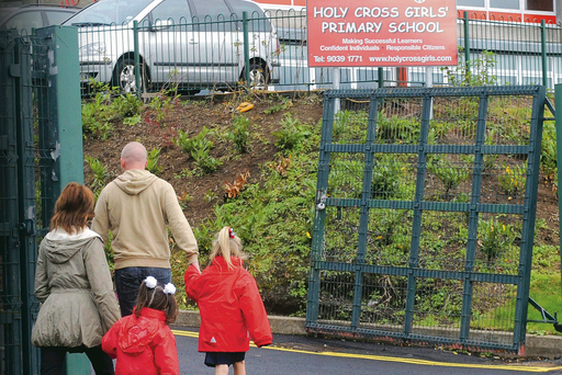 Children go to school at Holy Cross Primary School in north Belfast after threats were made against Catholic schools Colm Lenaghan/Pacemaker