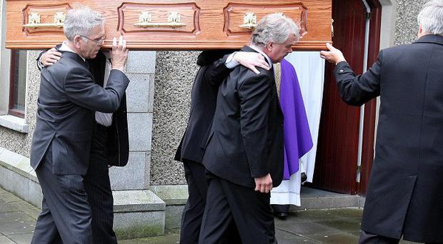 Cathy Dinsmore's funeral was held in Warrenpoint for her funeral, after her friend, Marian Graham, was buried earlier in Newry