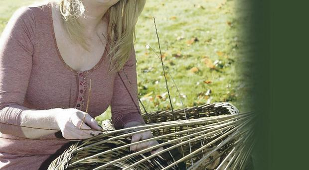 Louise McClean with one of her willow designs