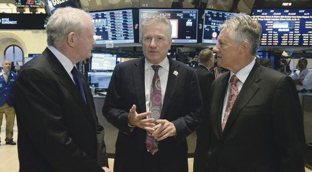 First Minister Peter Robinson and Deputy First Minister Martin McGuinness are shown the trading floor of the New York Stock Exchange by the chief executive of NYSE Euronext Duncan Niederauer