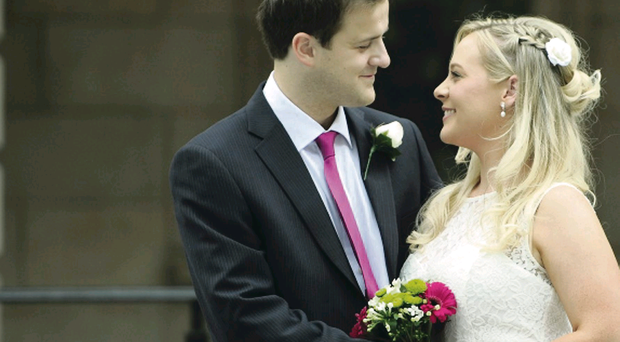 Loved up: Lucy Kearney and Edward Bell on their big day