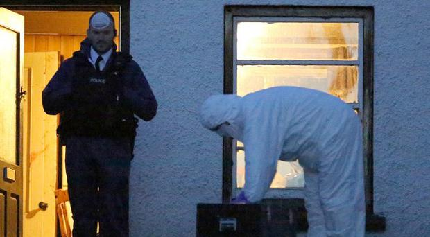 Activity at the scene in Glenarm, Co Antrim, where two men were found shot dead in a farmhouse