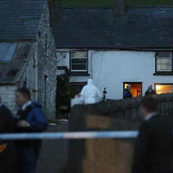 The scene in Feystown Road, Glenarm, Co Antrim, where two men were found shot dead in a farmhouse