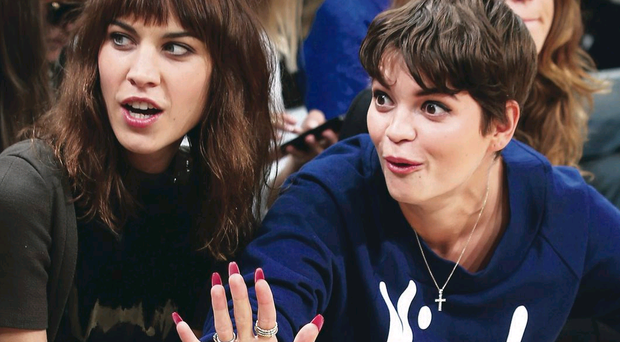 Pixie Geldof (right) and Alexa Chung at JW Anderson's show during London Fashion Week 2013