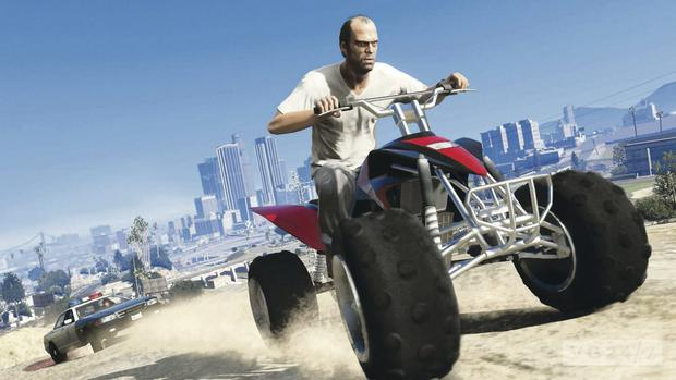 One of Grand Theft Auto's three leading characters, Trevor, driving a quad bike