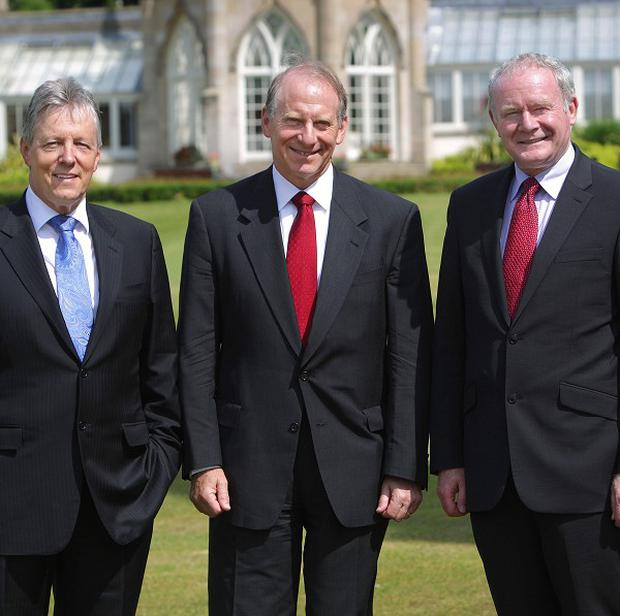 Dr Richard Haass, centre, flanked by the First and Deputy First Ministers, has begun political talks in Belfast