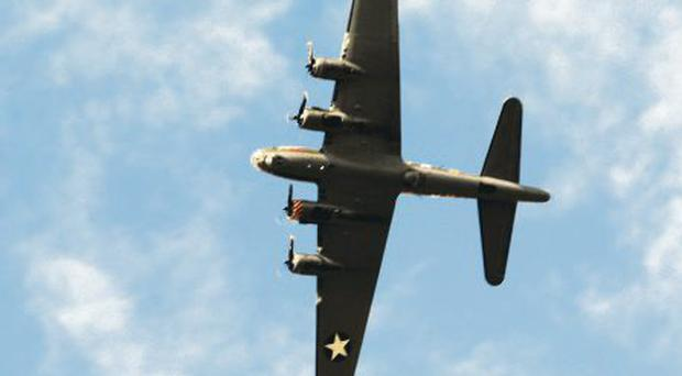 The Sally B on a fly-by of the cemetery on the Rocky Road, in the Castlereagh hills