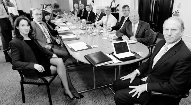 Richard Haass (right) assisted by Harvard professor Meghan O'Sullivan (left) during round table talks at the Europa Hotel, Belfast