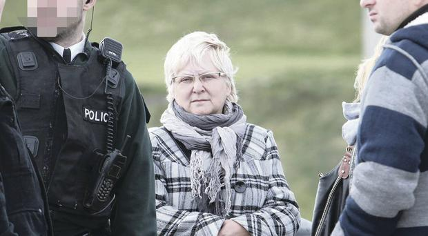 A police officer with Jaroslaw Andrykiewicz's mother Irena in Portrush y