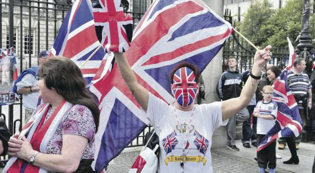 Some of the protesters taking part in a loyalist parade through Belfast city centre