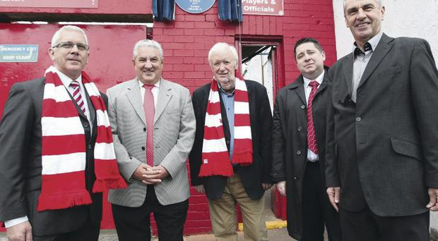 Alan Boyd, Secretary of the Ulster History Circle, Jim Boyce (FIFA Vice President and Cliftonville President), Tom Scott (Ulster Scots Agency), Gerard Lawlor (Chairman of Cliftonville FC) and Trevor Parkhill (Ulster History Circle) at the unveiling of an Blue Plaque for John McCredy McAlery