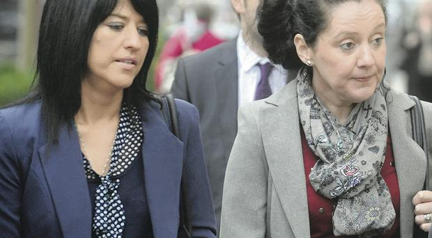 Liam Adams' daughter Aine (right) at Belfast Crown Court yesterday with her sister Sinead Rosbotham