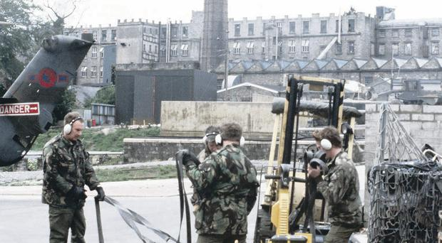 Army personnel work at the Bessbrook helipad