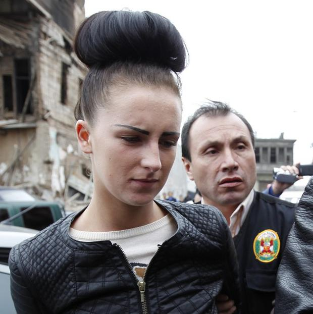 Michaella McCollum is escorted by police as she arrives at the Court in Callao, Peru (AP/Martin Mejia)