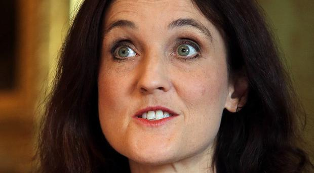 Theresa Villiers has said sectarian divisions and violence could destroy efforts to boost the Northern Ireland economy