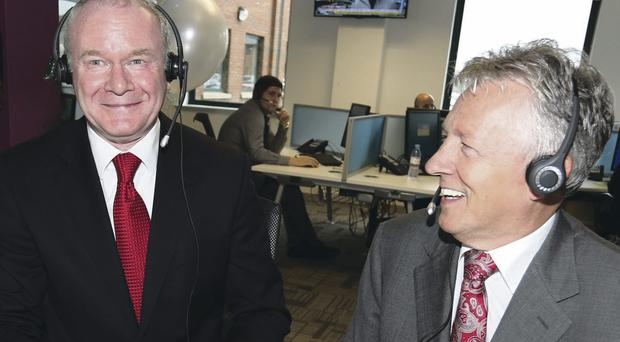 First Ministers Martin McGuinness (left) and Peter Robinson during a visit to Stream Global Services
