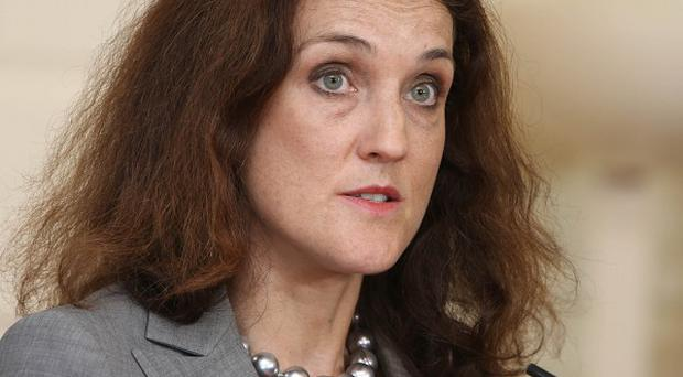 Theresa Villiers said the new commissioners would be appointed for three years but could have their term cut short if the Haass talks initiative finds a new adjudication process