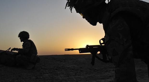 Soldiers from the 1st Battalion Royal Regiment Fusiliers conduct a dawn foot patrol in the Nahr-e Saraj district of Helmand Province, Afghanistan