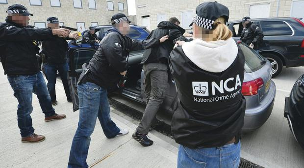 Officers of the newly-formed National Crime Agency train at the Northumbria Constabulary Ops Tactical Training Centre in South Tyneside