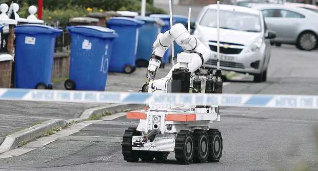 An Army robot examines a suspicious device at Brae Hill Link in north Belfast