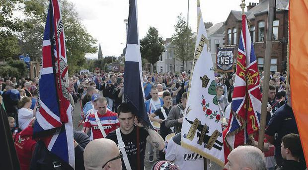 Orangemen and bandsmen gather close to Twaddell Avenue and the Ardoyne shop fronts