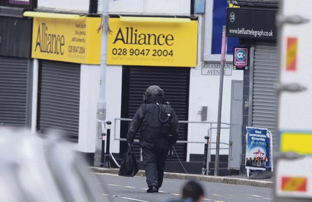 A 33-year-old man has been charged with placing a hoax bomb outside Alliance Party offices in east Belfast